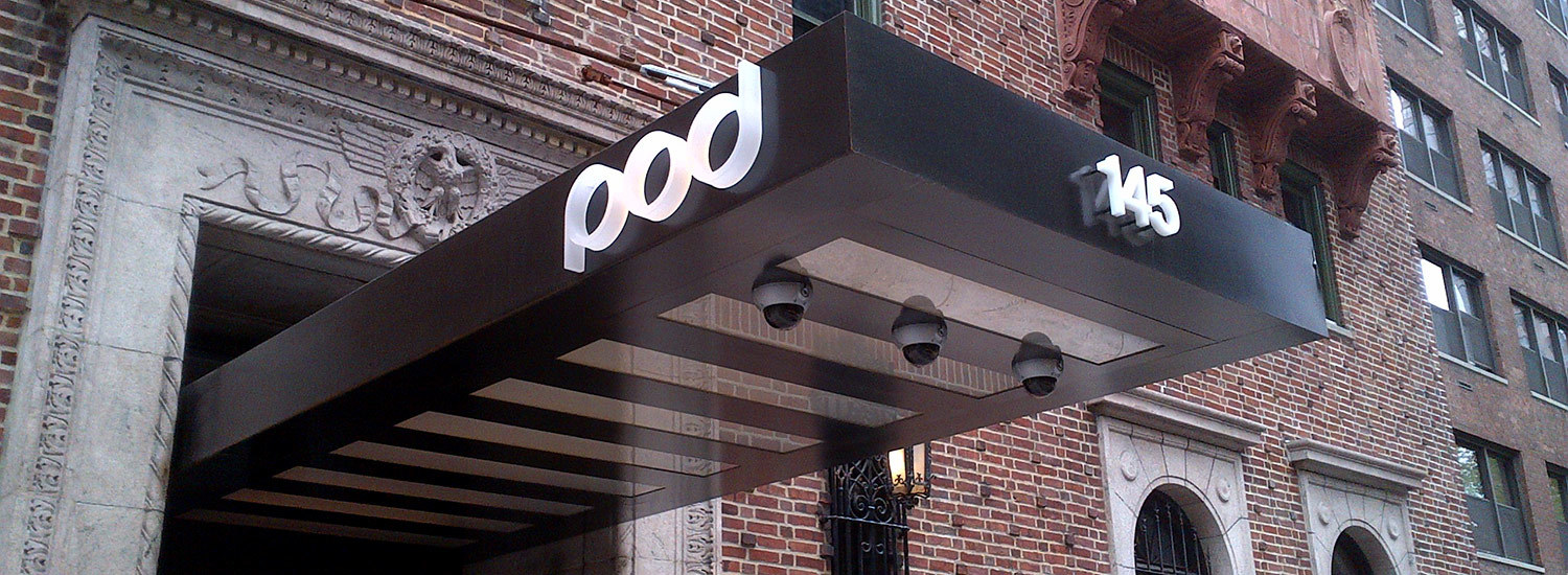 POD-HOTEL-NYC-BLACKEND-STEEL-CANOPY-WITH-ILLUMINATED-FROSTED-GLASS-CEILING-PANELS