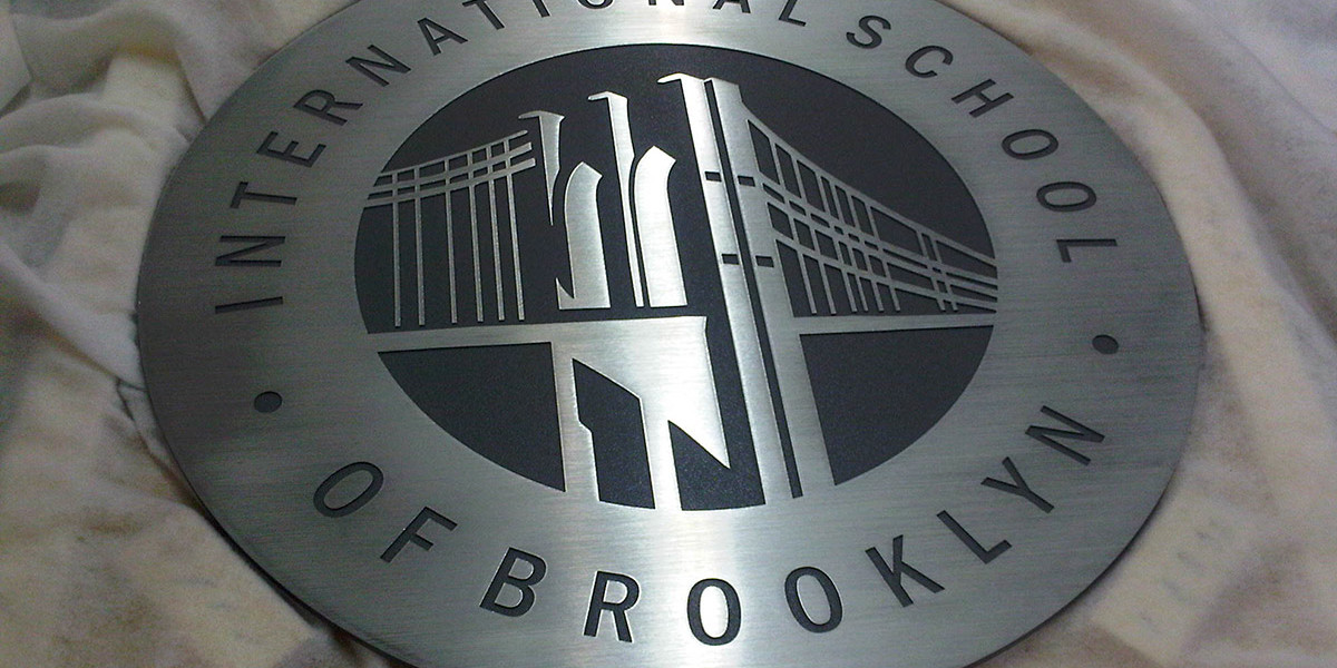 INTERNATIONAL-SCHOOL-OF-BROOKLYN-STAINLESS-STEEL-PLAQUE-WITH-ETCHED-LETTERS-AND-GRAPHICS