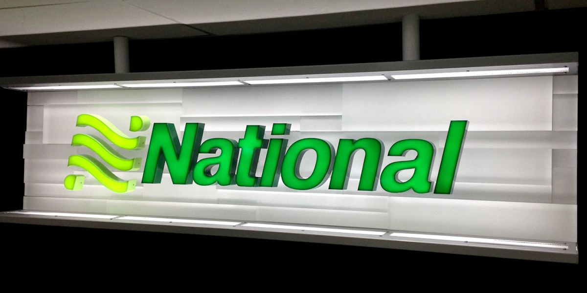 NATIONAL-CHANNEL-LETTERS-ON-CLEAR-ACRYLIC-BACKER-PANEL
