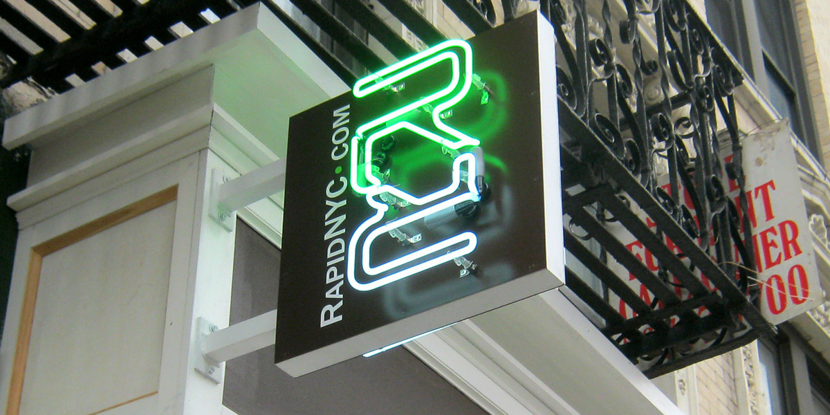 RAPID-REALTY-NEON-BLADE-SIGN